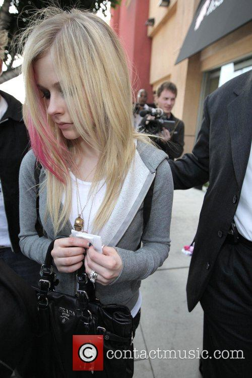 Avril Lavigne and her husband Deryck Whibley 13