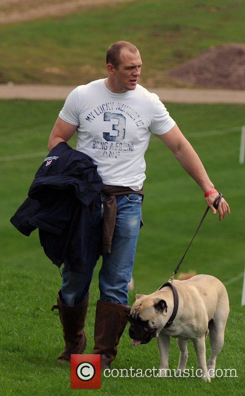 Mike Tindall walks with his dog during the...