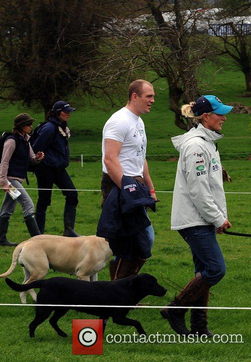 Mike Tindall walks with his girlfriend Zara Phillips...