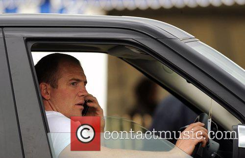 Mike Tindall sits at the wheel of a...