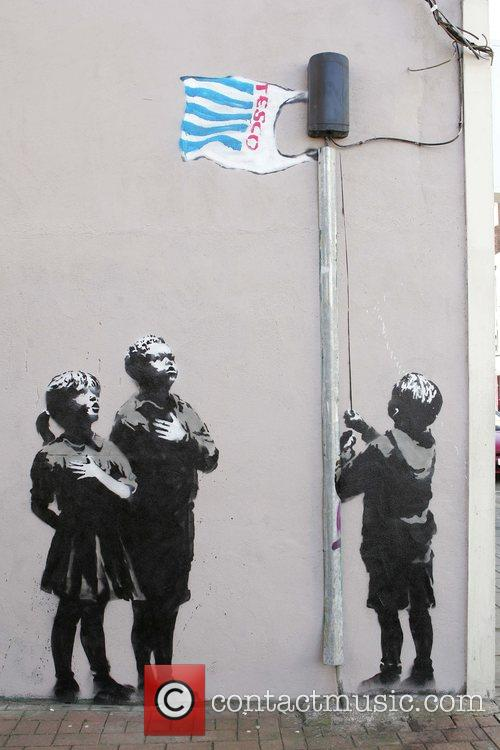 A new Banksy stencil in Islington featuring a...