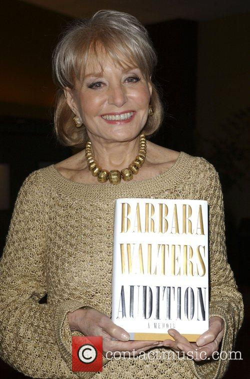 Barbara Walters signing copies of her new book...