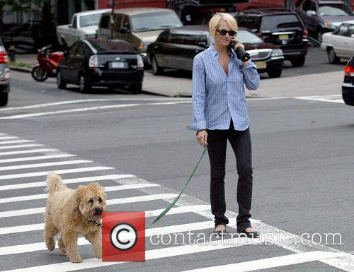 Actress Ellen Barken walks her dog on White...