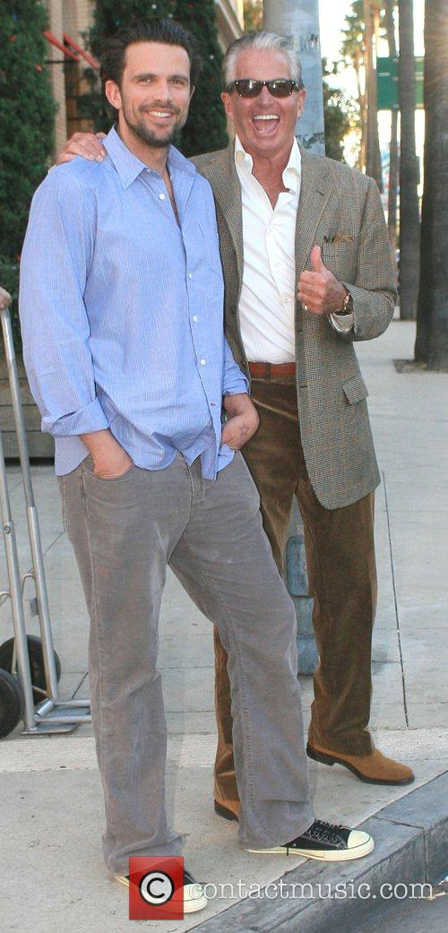 George Hamilton with a friend leaving Barney's New...
