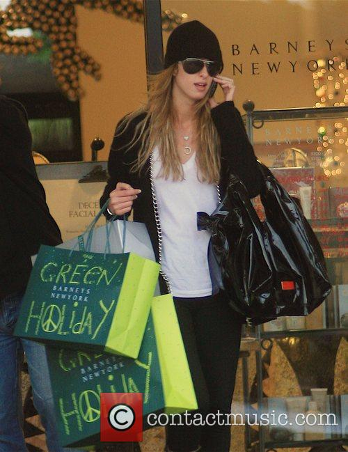 Nicky Hilton carrying large shopping bags while leaving...