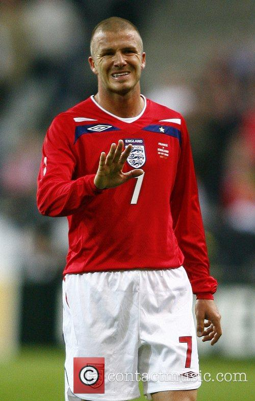 David Beckham of England with the ball as...