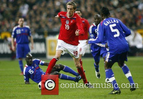 Peter Crouch of England in action during France...