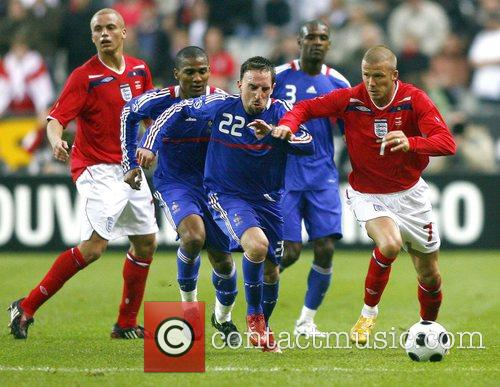 Left to Right: England's defender Wes Brown, France's...