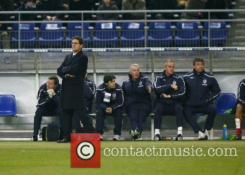 Fabio Capello and his team during France v...