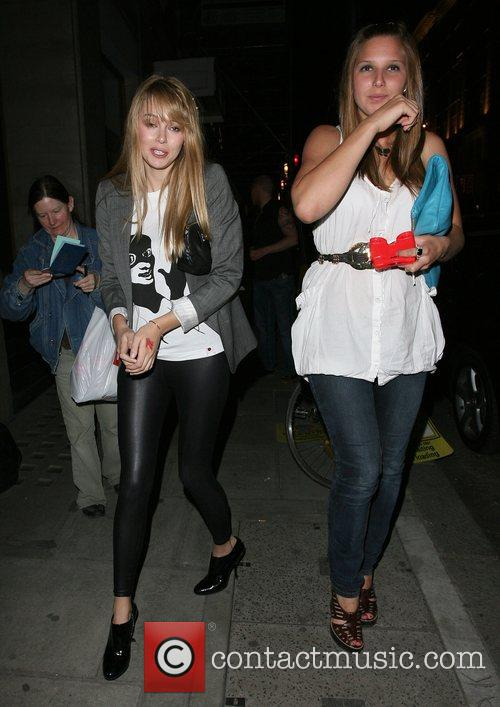 Keeley Hazell and a friend rather worse for...