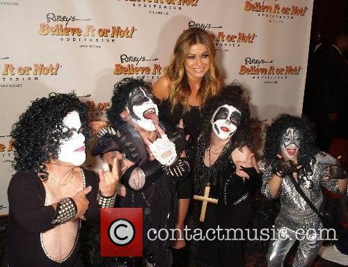 Carmen Electra and Mini Kiss opening celebration of...