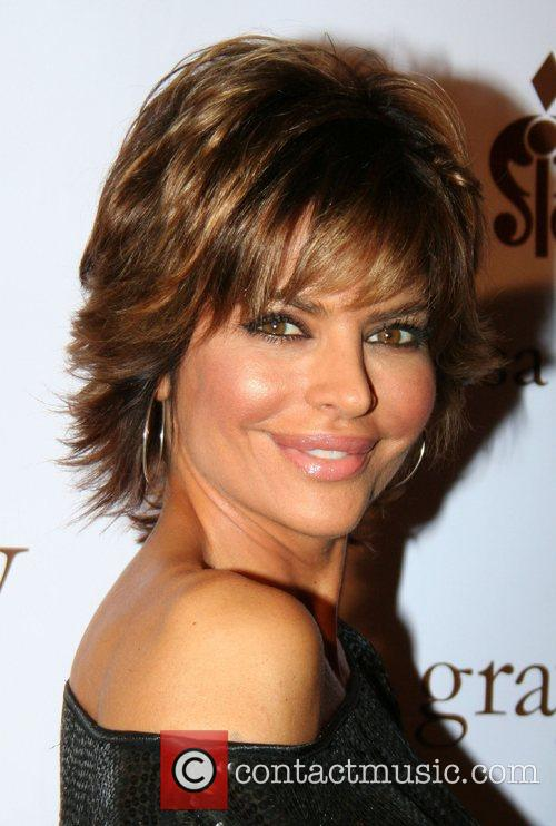 Actress and fashionista Lisa Rinna celebrates the grand...