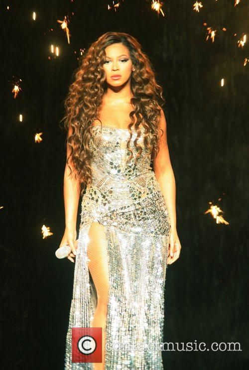 Performing live in concert on 'The Beyonce Experience'...