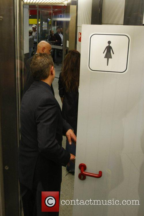 Penelope Cruz leaving the restroom at Tegel airport...