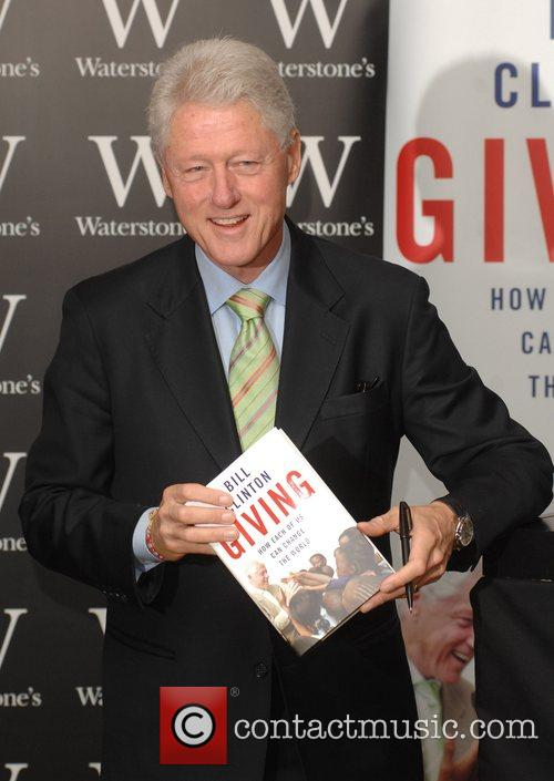 President Bill Clinton signs his new book 'Giving:...