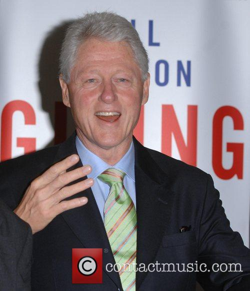 Former President Bill Clinton signs his new book...