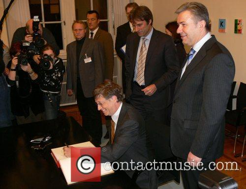 Bill Gates signing Berlin's Golden Book at the...