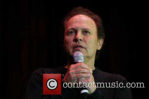 Billy Crystal performs at the George Washington University's...