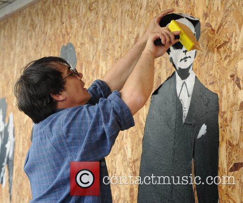French artist Blek Le Rat decorates the shop...