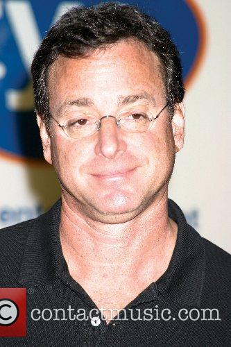 Bob Saget signs DVD copies of his brand...
