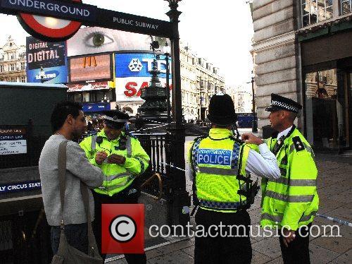 A police cordon is established around a car...