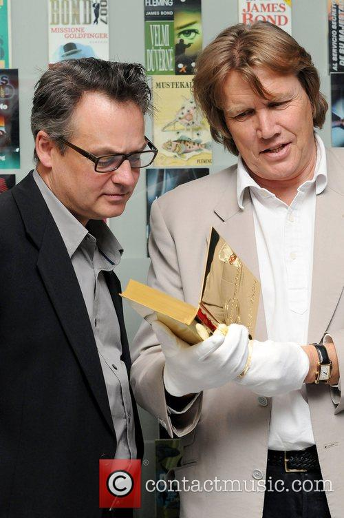 Unveil a solid silver 24-carat gold-plated book to...