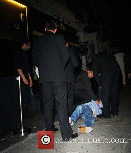 A club member is forcefully thrown out of...