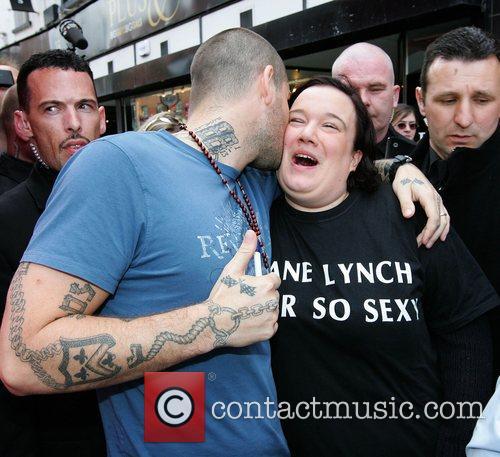 Shane Lynch of Boyzone jokes with a fan...