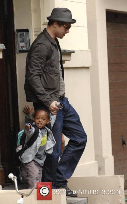 Brad Pitt picking up his kids Zahara and...