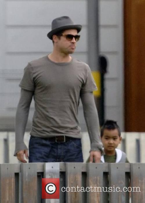 Brad Pitt picks up son Maddox from school...