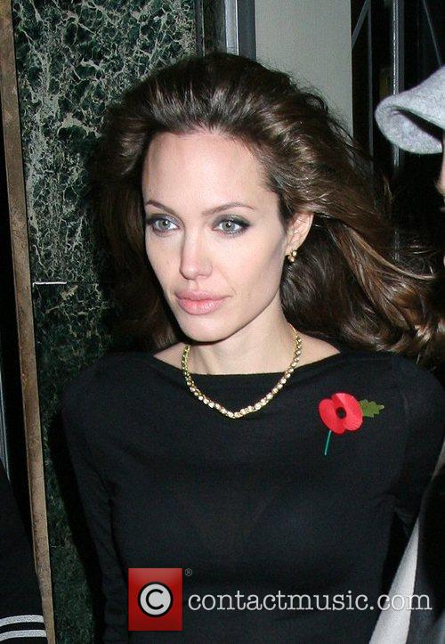 Angelina Jolie and Brad Pitt leave their hotel...