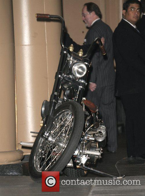 Brad Pitt wearing a crash helmet leaves the...