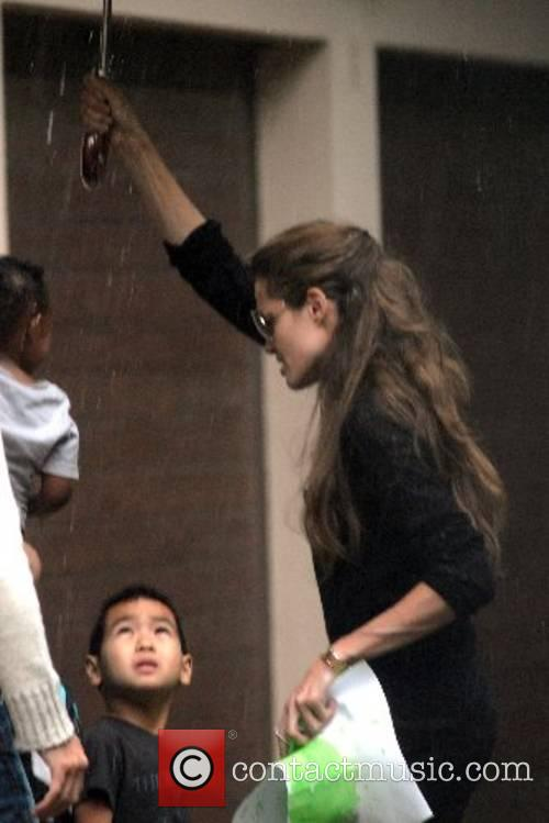 Angelina Jolie and Maddox pick up Zahara from...
