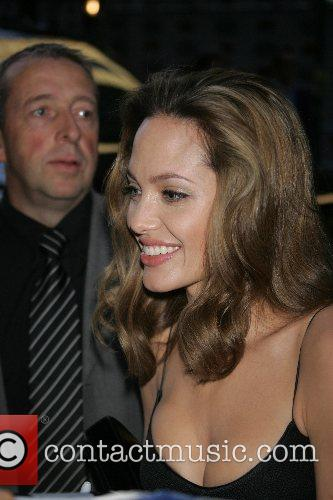 Brad Pitt and Angelina Jolie sign autographs for...