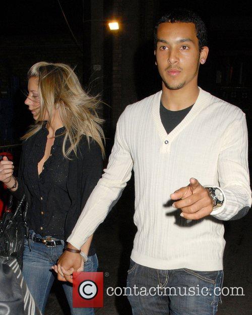 Melanie Slade and Theo Walcott arrive at the...