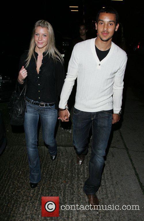 Melanie Slade and Theo Walcott walking along Brick...