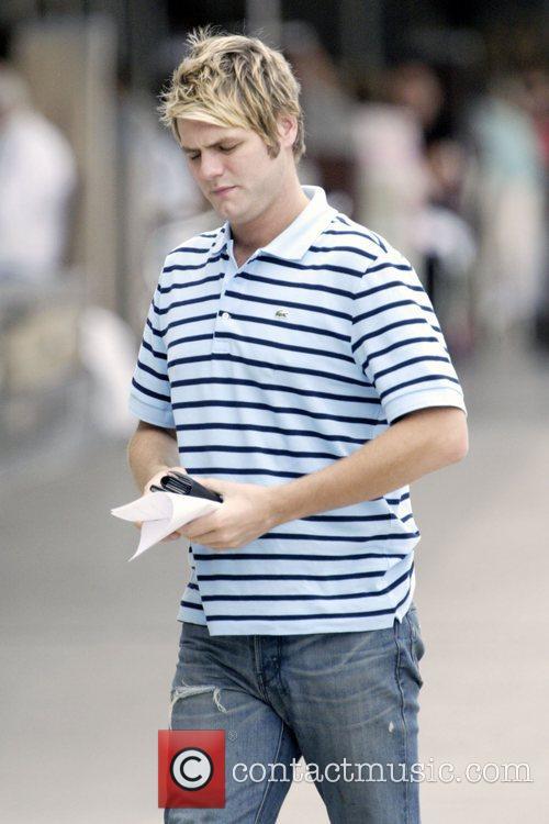 Brian McFadden walking into Delta Goodrem's apartment on...