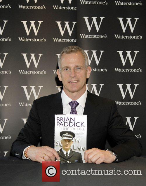 Signs copies of his new book 'Line Of...