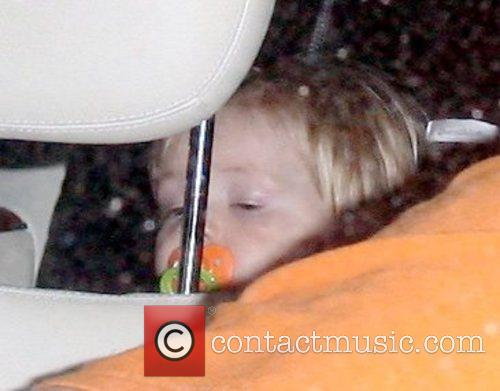 Being supervised in the car while his mother,...