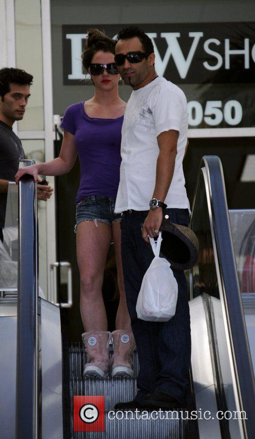 Britney Spears in cut-off jeans with her new...