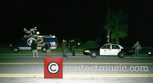 Photographers and police outside Britney's residence SPEARS HOSPITALISED...
