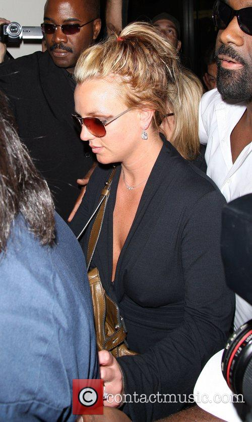 Britney Spears is mobbed by the paparazzi as...