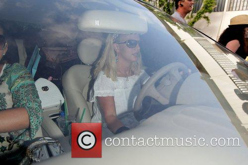 Britney Spears dressed in a skimpy white dress...