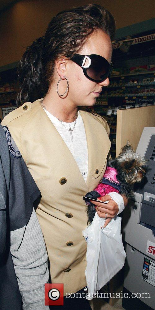 Britney Spears is accompanied by her dog London...