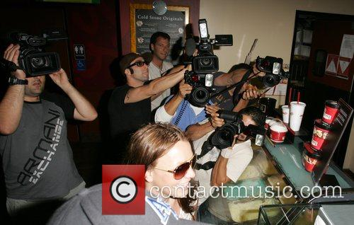 Britney Spears  is surrounded by photographers as...
