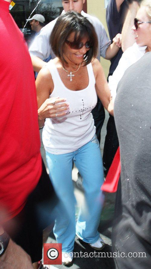 Lynne Spears squirts water on the mob of...