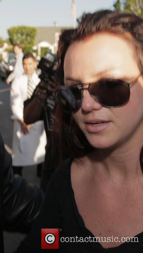 Britney Spears is followed by a frenzy of...