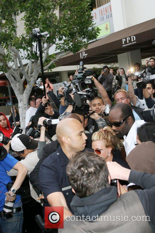 Britney Spears is greeted by a frenzy of...