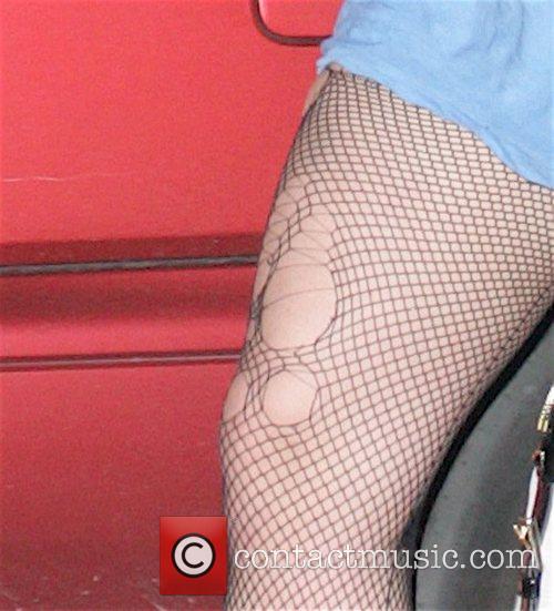 Britney Spears leaving a dance studio wearing torn...