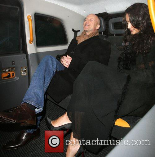 Bruce Willis, His New Girlfriend Emma Heming Arrive Back At Their Hotel and Having Had Had Dinner At The Ivy Restaurant. 2